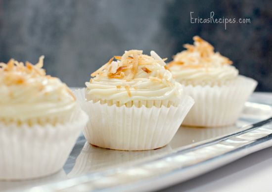 Pineapple-Coconut Cupcakes with Honey Cream Cheese Frosting. Fluffy, decadent bits of heaven! #cupcakerecipes http://thecupcakedailyblog.com/pineapple-coconut-cupcakes/