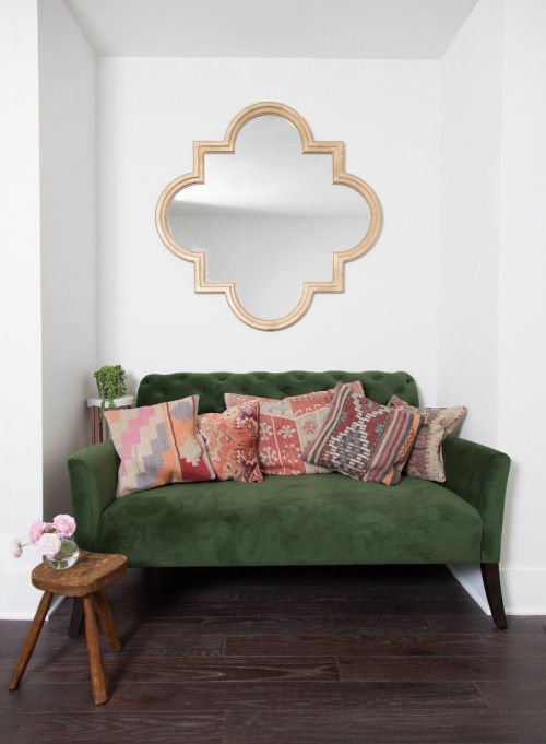 I wanted to create something really eye-catching in this cute little nook, and when I stumbled on this emerald velvet settée, I knew it was just the bold statement I was looking for. Claire sprayed the mirror gold to add a touch of glamour (we posted the DIY here) and layered an eclectic mix of vintage pillows for a bohemian vibe. (Elton settée from West Elm.)