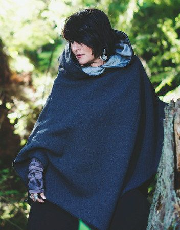 This poncho is made from wool and cashmere. The hood is made with a silk/linen fabric giving it that great contrast. Made to fit all bodies. You