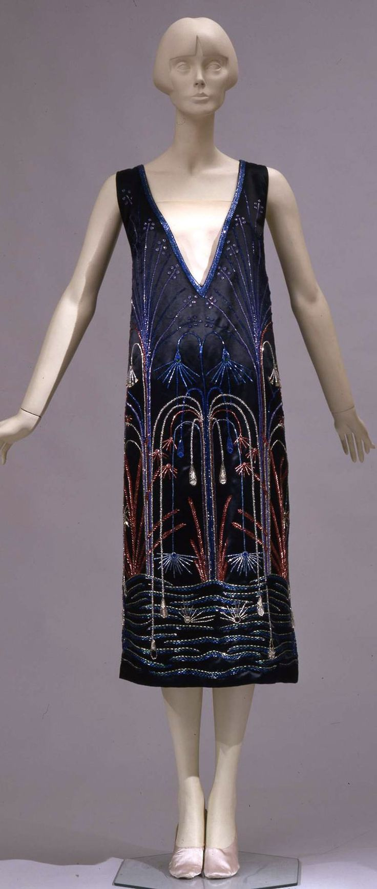 Evening dress, Sartoria Ventura, Rome (?), ca. 1925. Short sleeveless dress in black silk satin, embroidered with glass straws. Collection Galleria del Costume di Palazzo Pitti