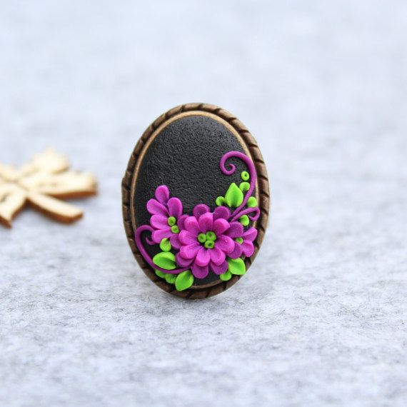 MiniMi Jewelry Polymer Clay Ring This is a unique, handmade, polymer clay ring with lilac flower motifs. The base of the ring is antique bronze