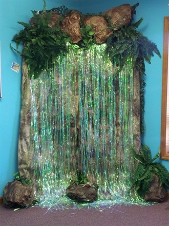 pvc pipe for frame, craft paper for boulders/rocks/ background spray painted brown & green handing decorations for waterfall