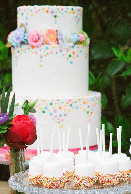Confetti-Dotted Sprinkle Wedding Cake and Nonpareil-Covered Cake Pops | Brides.com