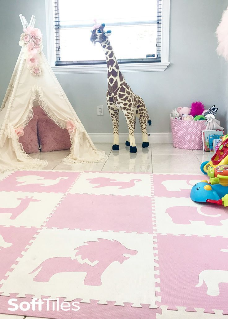 Light Pink and White Safari Animals makes this room into a beautiful girls playroom.
