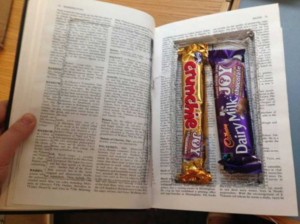 Surprise Stash of Sweets Found in hollow book at Cambridge Library