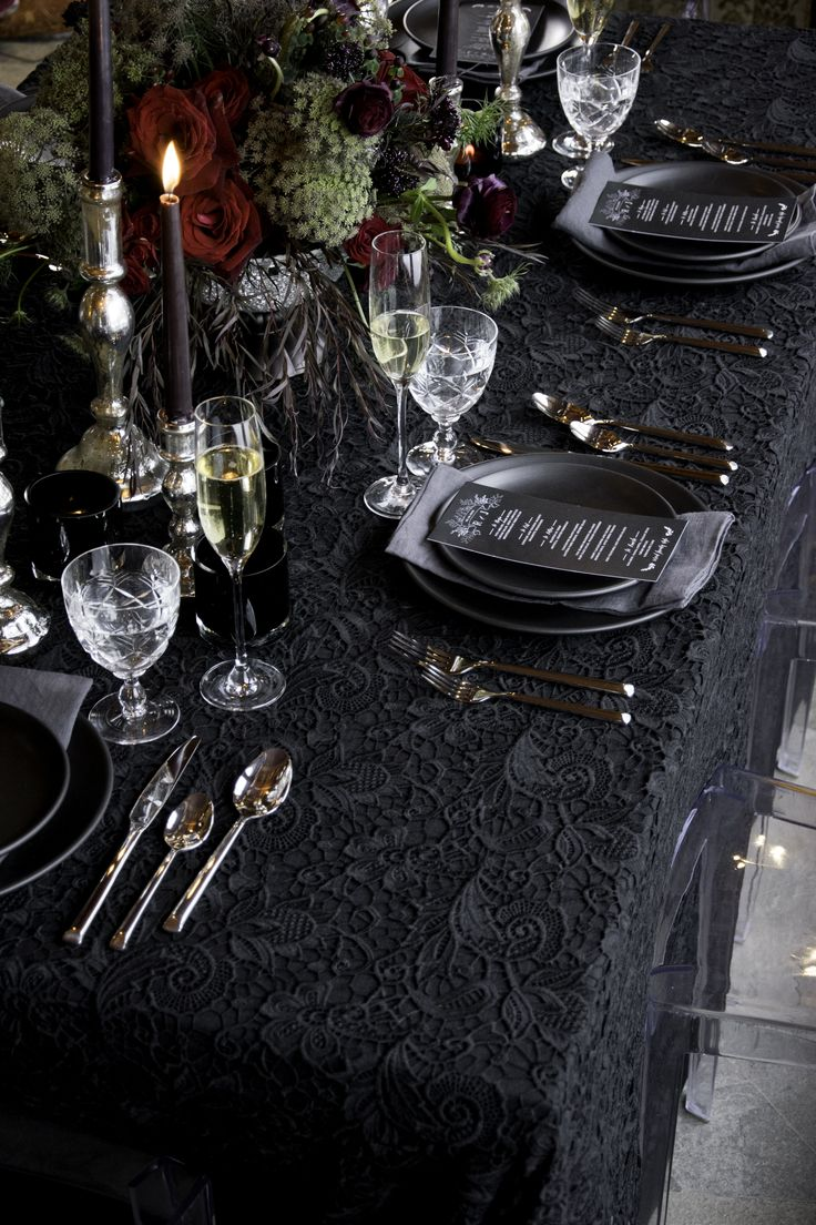 "I am always inspired by the dark and glamorous, so when inspiration struck for this moody table scape I ran with it. It wouldn't exactly work for Christmas or Easter; but it would be a show stopper for New Years Eve. For this table scape we worked with more texture than colour; linen, lace, ceramics, florals – all in the darkest of night tones. A simple basic black linen as a base, topped with our Juliette macrame lace topper in Noir. Paired with our 22"" linen dinner napkins in Charcoal."