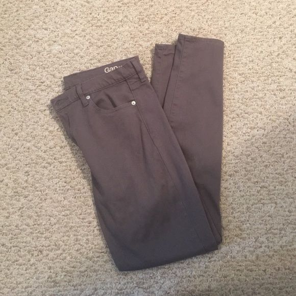 Gap Pants Grey gap pants.  They do not feel like jeans more like jeggins with a slight shiney ness to them super comfy and super long! Smoke free home GAP Pants