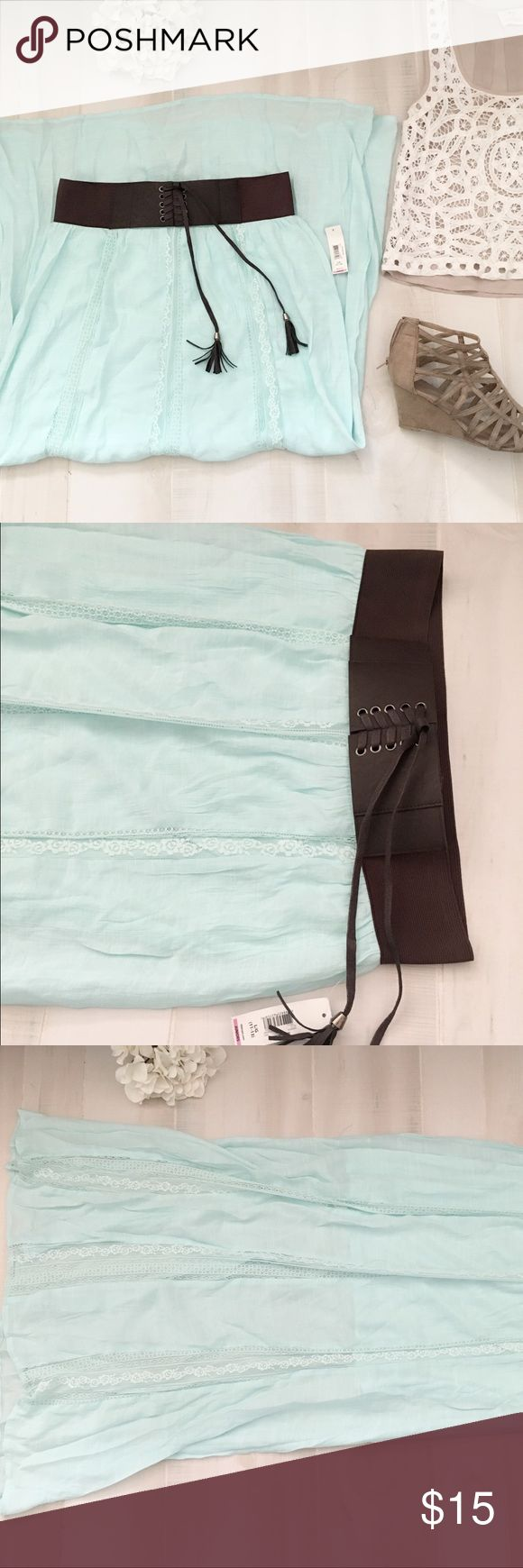 "Boho maxi mint maxi skirt Cute boho maxi skirt. Mint colored with elastic thick faux waist belt with tassels. Textured fabric with alternating floral lace stripes. Has shorter lining. Size L, juniors. Waist 15.5, waist to hem 40"". Skirts Maxi"