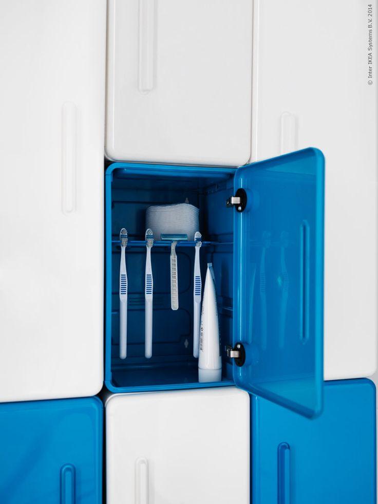 LEJEN skåp med hylla för tandborstar och rakhyvlar.