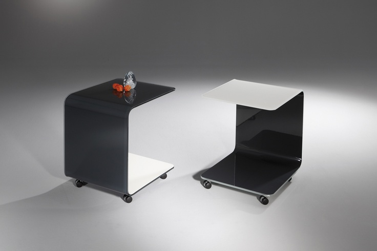 ZABO - Made of curved OPTIWHITE glass, this rolling table appears crystal clear by itself due to its curved and yet straight form. For more information: http://www.dreieck-design.com/en/products/side-tables/zabo/