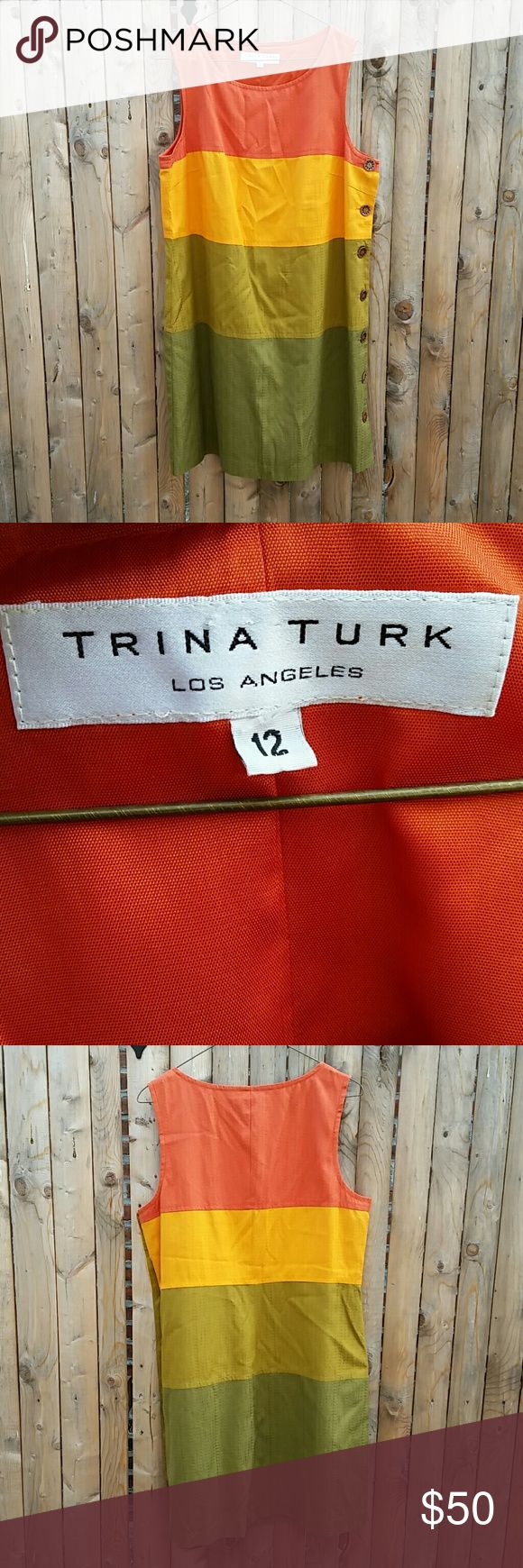 Trina Turk silk/cotton blend shift dress sz 12 Beautiful multi-colored shift dress from Trina Turk! Very gently worn and in excellent condition! There is a very small snag on the back bottom left side of dress where one of the sitiches got caught on a hanger -- otherwise in excellent condition! No holes, stains, tears, or defects! Wooden side buttons and orange lining with lace edge elevate this dress!  Orange/dandelion/yellow green/green Size 12 Body: 68% silk 32% cotton  Lining: 100%…