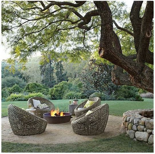Beautiful furniture, nice fire pit and stone wall, lovely setting, covet all.