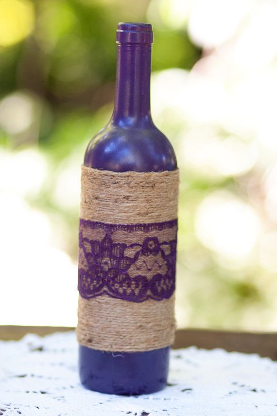 Decorated wine bottle plum eggplant color accented by DreamItCraft, $12.00 Diy even easier with a burlap ribbon, lace ribbon & tie with twing