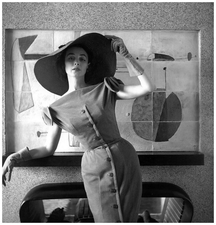 Dorian Leigh in a figure-hugging dress by Jacques Fath, photo by Georges Dambier, Nouveau Femina, March 1954