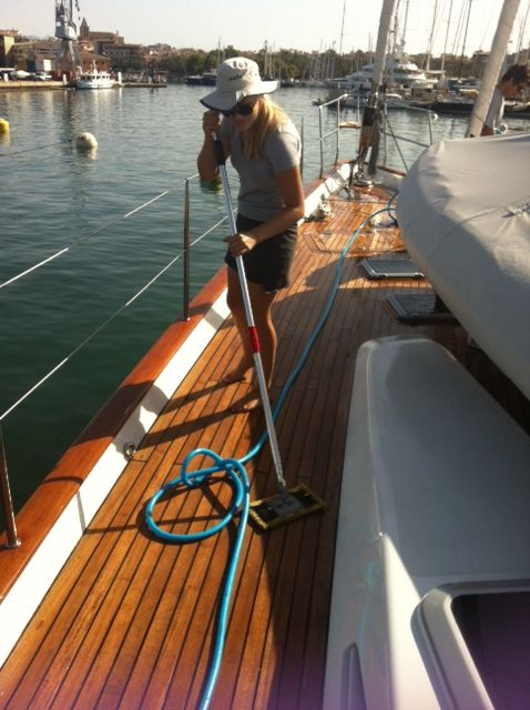 The beautiful Amy with her ENJO Yachting deck pad, and just water, to clean the teak decks