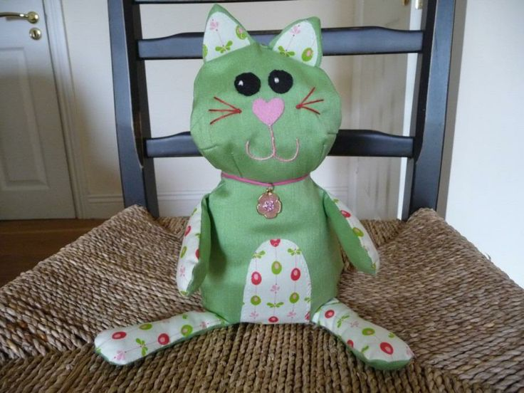 """Rosie"" Gentle Cat – Green A collectible keepsake, sewn and designed by Fionas Handcrafts in Ireland Handmade, soft, and stuffed with polyester hi loft filling. Sewn using soft high quality silky cotton/mix fabric for her body, and a gorgeous mixture of fabrics for parts of her tummy, ears and legs. Comes with a sewn on tag label. http://www.marketdirect.ie/toy-rosie-female-cat-green"