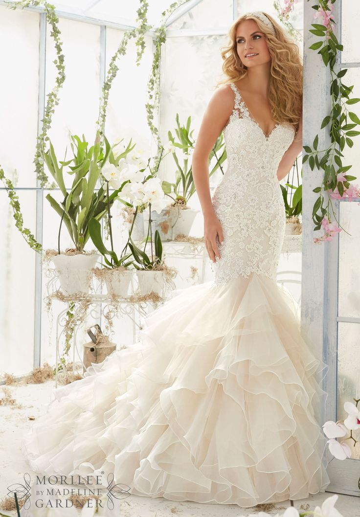 "Wedding Dresses and Wedding Gowns by Morilee featuring Vintage Pearl and Crystal Beading on Alencon Lace Appliques Over Chantilly Lace onto an Organza and Tulle Flounced Mermaid Gown Available in Three Lengths: 55"", 58"", 61"". Colors available: White, Ivory, Ivory/Light Gold, Ivory/Blush."