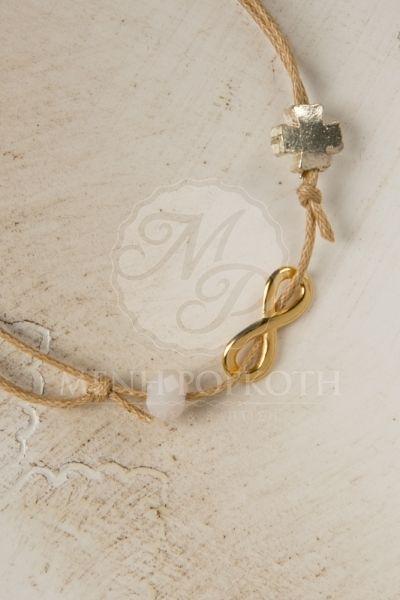 Μαρτυρικά βραχιολάκια για βάπτιση από κερωμένο μπεζ-καφέ κορδόνι με χρυσαφί μεταλλικό διακοσμητικό σχήμα του άπειρου