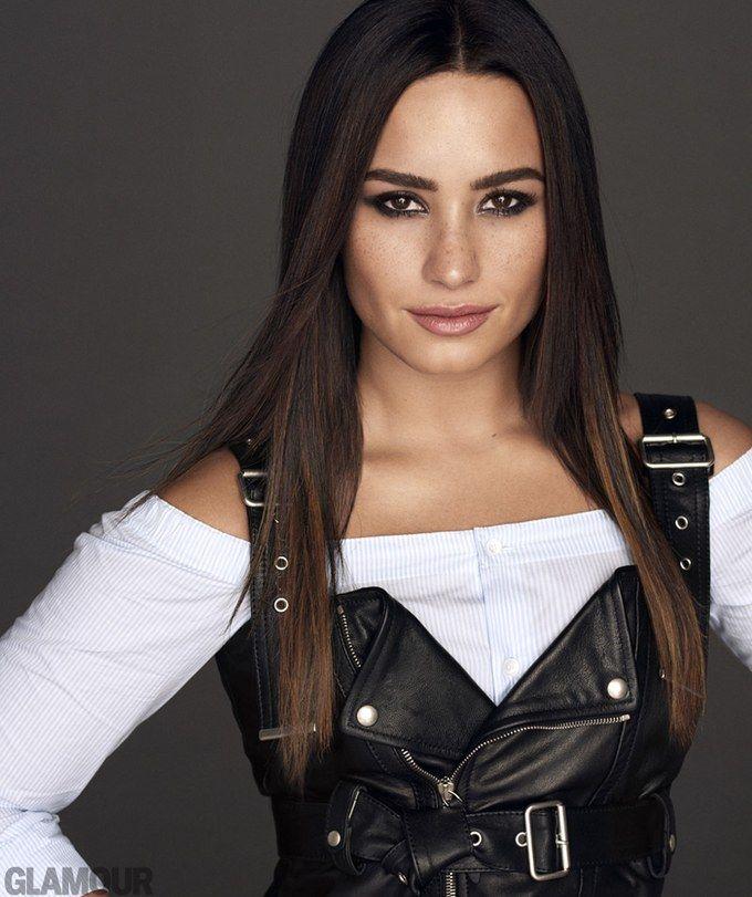 Demi Lovato in Glamour Magazine wearing a Diesel Black Gold leather dress, cotton shirt. Bulgari rings.