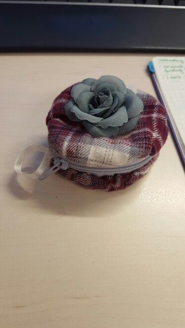 A little round zippered bag to keep game pieces in.