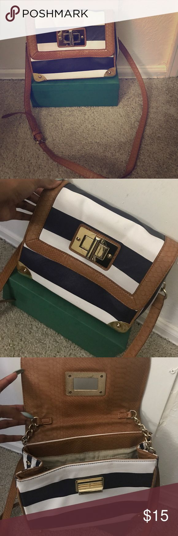 Navy and white striped Aldo purse Cleaning out my closet and just wanted to get rid of stuff that I've had for a while. Navy and white striped Aldo purse trimmed in gold and light brown in good condition! Aldo Bags Satchels