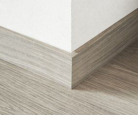 modern skirting with a hidden gap behind for hiding phone/ethernet cables