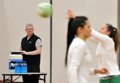 Daughters got 'accidental coach' involved: Manawatu co-coach John Atkins watches his team warm up at the Edgar Centre in Dunedin yesterday. Photo by Craig Baxter.#LFNC