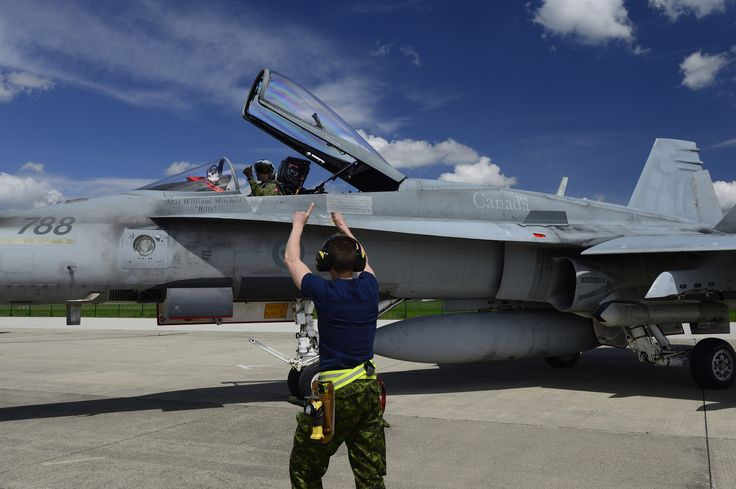 """Tail Number (788): Lieutenant-Colonel Darcy """"Plug"""" Molstad, Canadian Air Task Force Commander and CF-18 pilot, gives a """"thumbs up"""" to ground crew to prepare for a local familiarization flight of the region in Câmpia Turzii, Romania during NATO reassurance measures on May 13, 2014.   Photo by MCpl Patrick Blanchard, Canadian Forces Combat Camera (IS2014-3023-16)"""