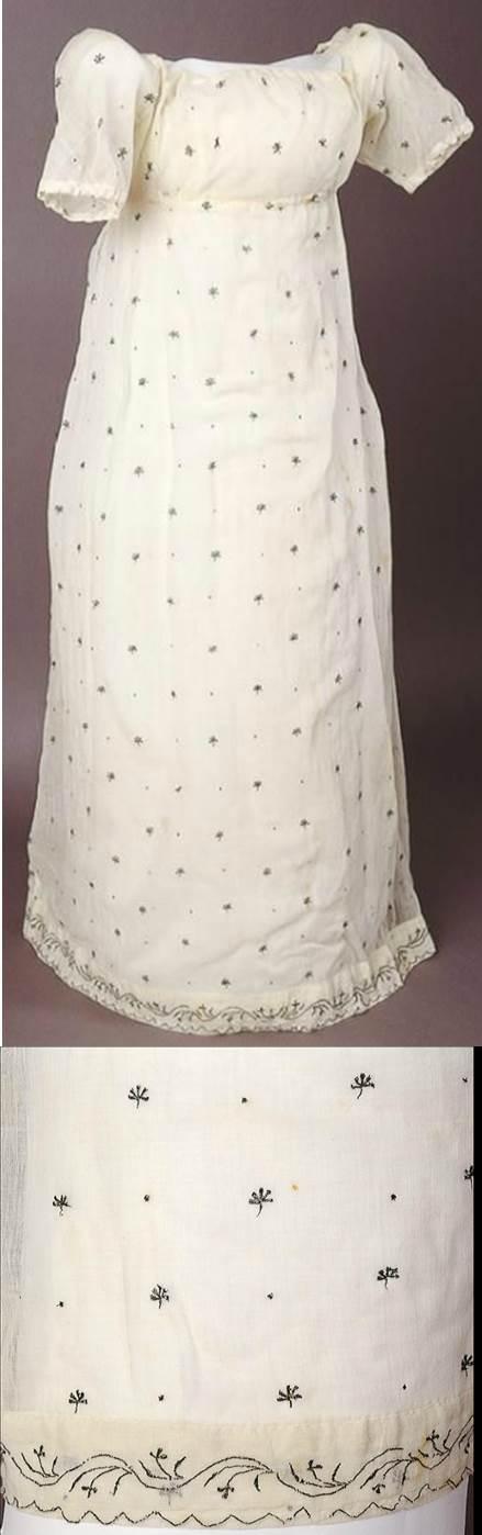 White muslin dress embroidered with metallic thread in a sprig design. Worn by Anna Jospha King. 1805 Australian Dress Registry.