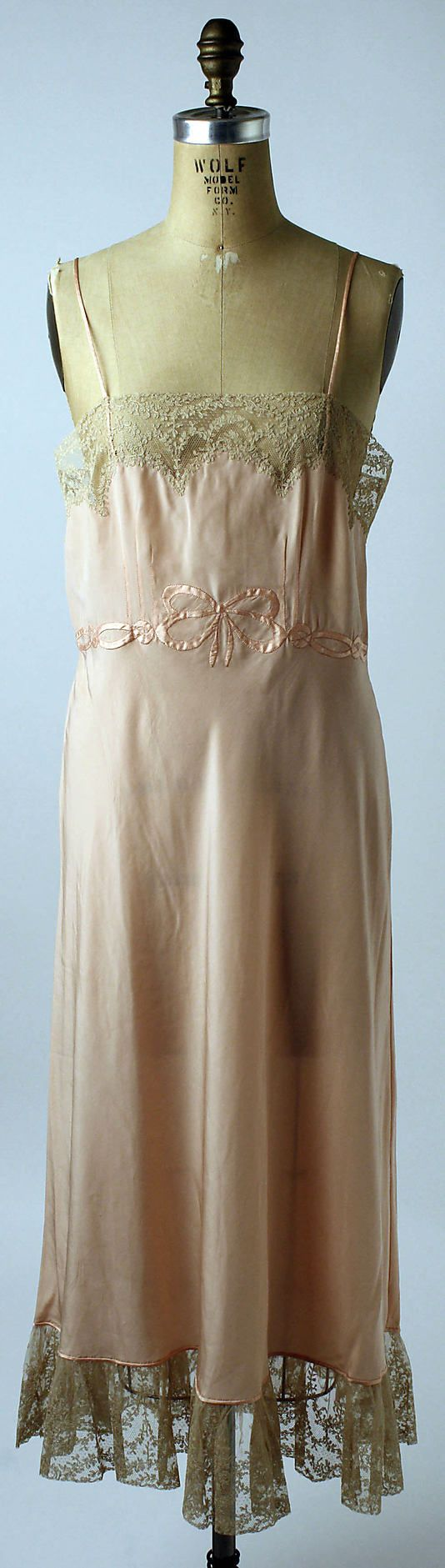 Slip  Date: ca. 1946  Culture: French  Medium: silk, linen  Dimensions: Length at CB: 40 1/2 in. (102.9 cm)  Credit Line: Gift of Mrs. Maxime Hermanos, 1986  Accession Number:      1986.126.2