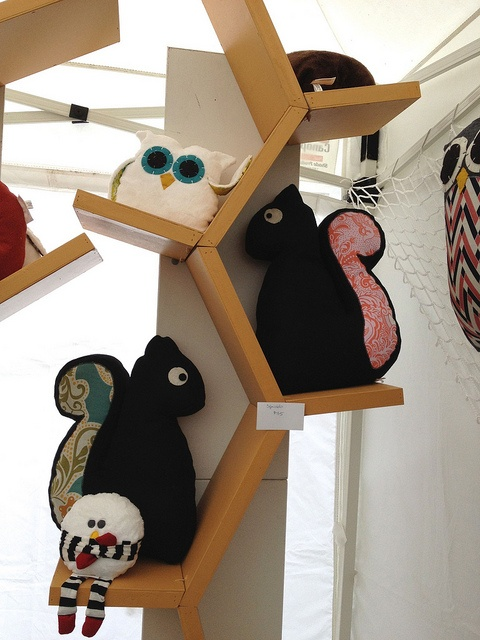 The shape of this shelf suggests a tree - A great place to display little squirrels and owls.