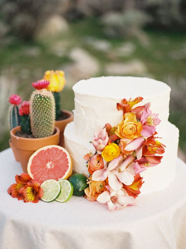 wedding cake with floral accents, photo by Chelsea Scanlan http://ruffledblog.com/cinco-de-mayo-wedding-ideas #weddingcakes #cakes #cincodemayo
