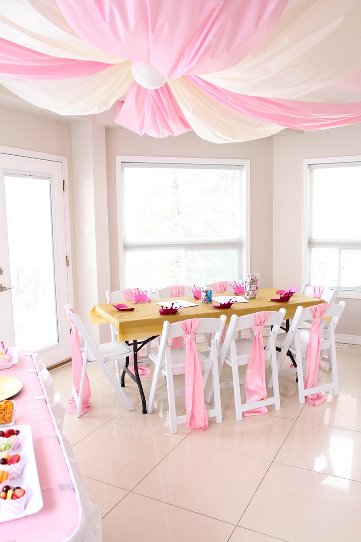 Pink and cream ceiling draping, helps to create a royal atmosphere