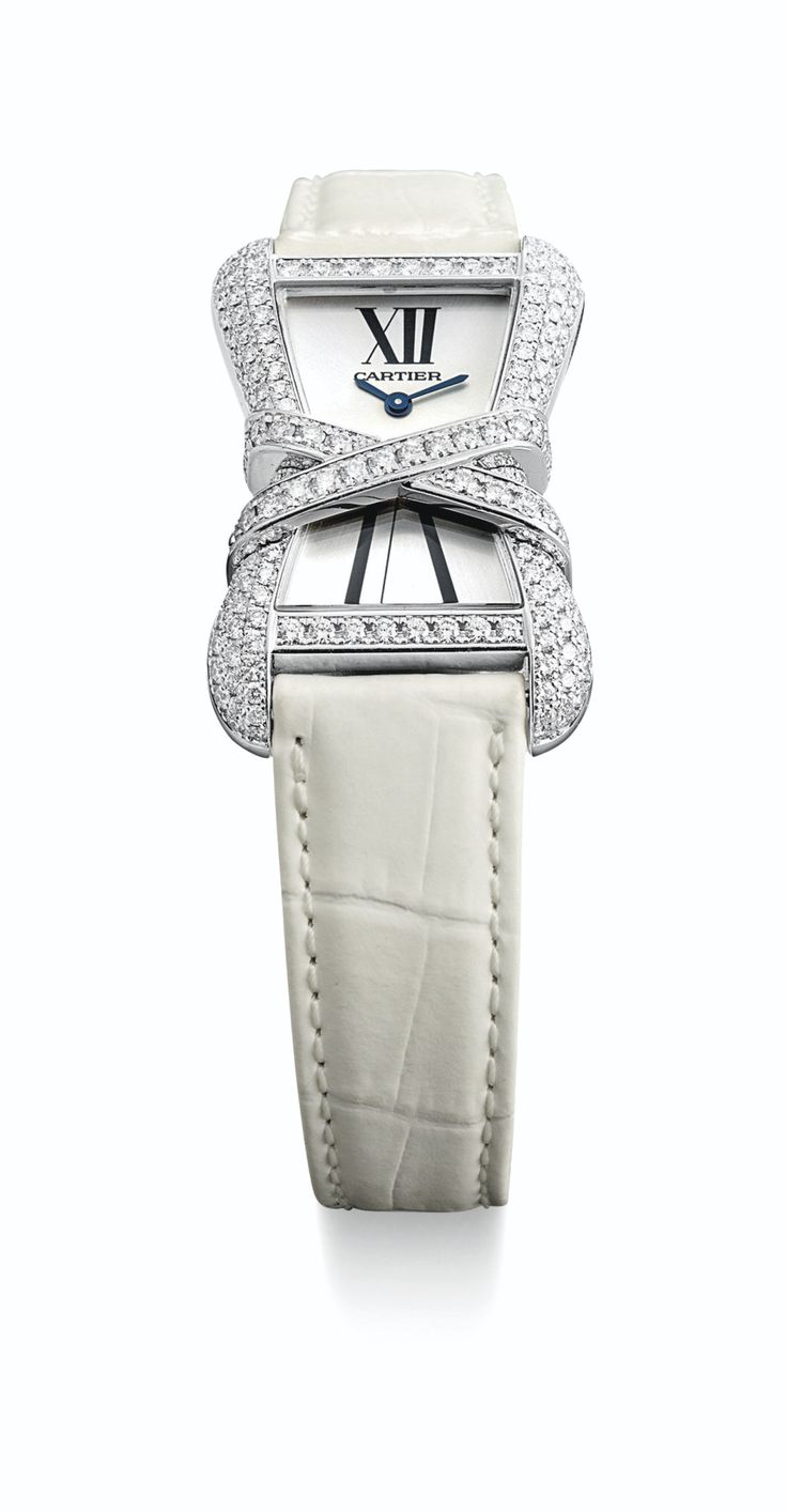 Cartier A FINE LADY'S WHITE GOLD AND DIAMOND-SET RECTANGULAR WRISTWATCH TANK ENLACÉE CIRCA 2010