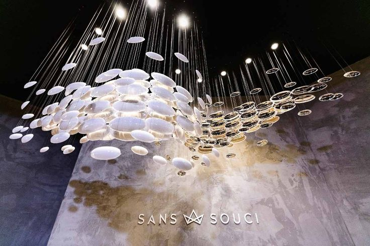 Bowls by @kackakacka for Sans Souci - the beauty of the modern light fixture centres on a simple shape and the ever-attractive contrast. The smooth hand-blown bowls were rotated ninety degrees and suspended with the convex parts facing one another. This created a wave that is very elegant yet also pleasantly disordered.