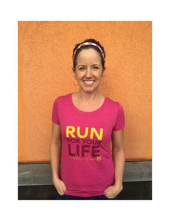 We do love a good play on words at Another Mother Runner. Presented with a bold graphic punch, this shirt is our new fav! Let's admit it: While many of us run for the life-extending benefits of exercise, a boatload of us also head out the door to maintain our spirit and spunk. The (not-medically accurate) EKG line extending from mom shoelaces under the phrase makes us smile, too.