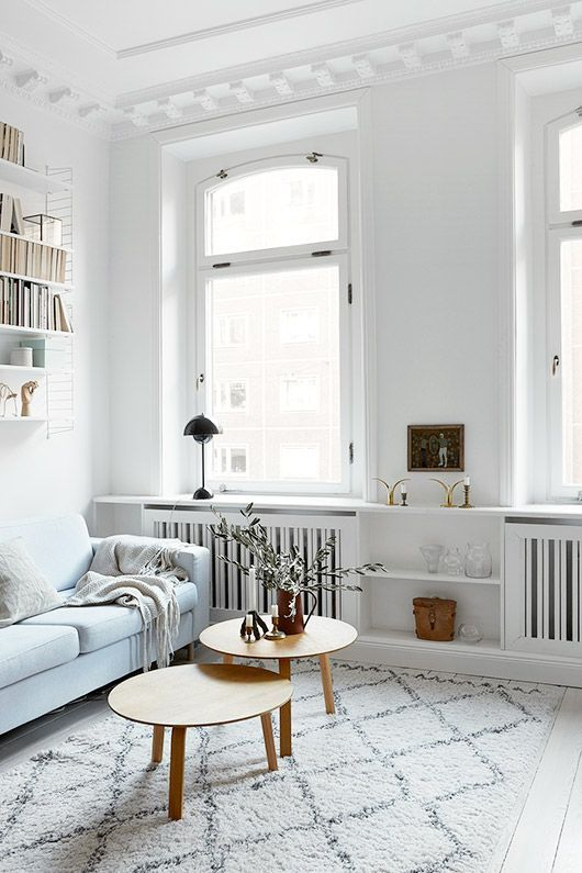 White and wood in the living room, staggered coffee tables | frank is always fantastic