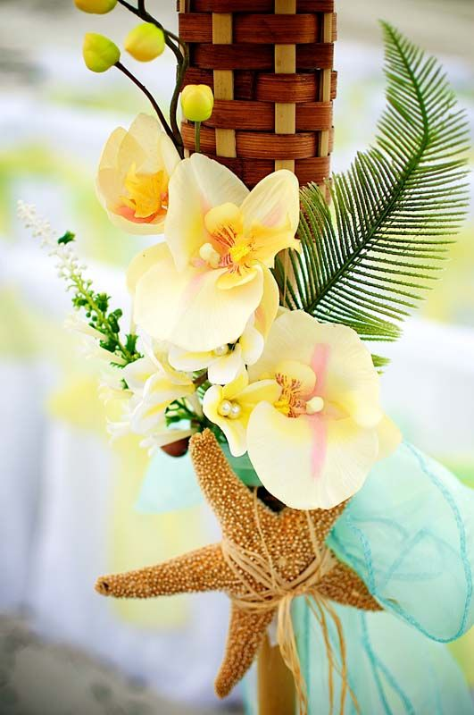yellow plumeria wedding flowers, starfish, aqua sash