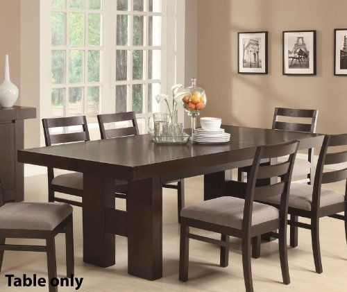 Wood Dining Table with Pull Out Extension Leaf in Cappuccino Finish by Coaster Home Furnishings. $549.00. Cappuccino finish. Ash solids and hardwoods. Pull out extension leaf. Matching chairs available separately. Dimensions: 71-86.5L x 39.25W x 30.75H. This transitional dining table made of ash solids and hardwoods in cappuccino Finish provides easy-going style to your casual or semi-formal dining room. The modern table features clean lines with the substantial H-form dou...