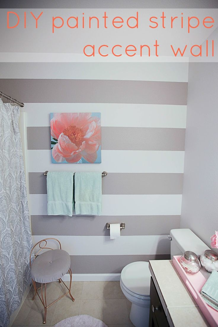 DIY painted striped accent wall - grey and white striped bathroom painting