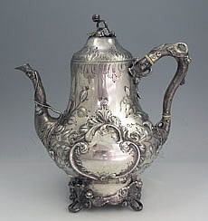 """Eoff and Sheppard Coin Silver Teapot  An antique coin silver teapot by Eoff and Sheppard for Ball Black and Co of New York. Hand chased decoration of leaves and scrolls and a naturalistic handle and spout. The lid hinges to open. Monogrammed on one side in the cartouche. Circa 1860.  Height: 10"""". Weight: 29.5 troy ounces.  Price: $2,850.00"""
