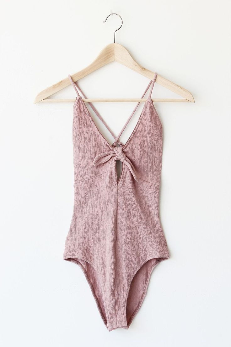 - Details - Size - Shipping - • 75% Cotton 20% Polyester 5% Spandex • Textured bodysuit with adjustable strap lengths and clasp closure. • Hand Wash • Line dry • Imported • Measured from small • Lengt
