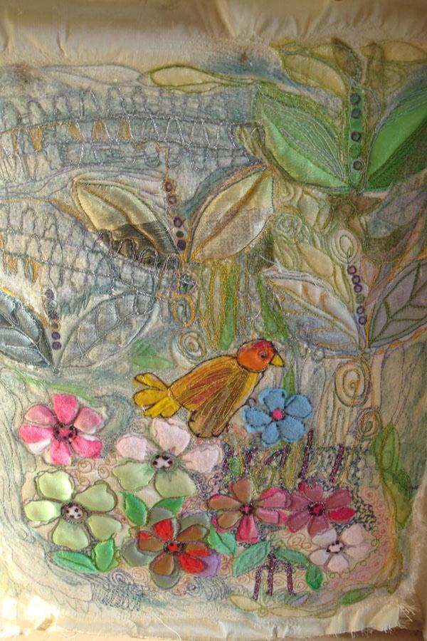 Another birdie embroidered on silks.