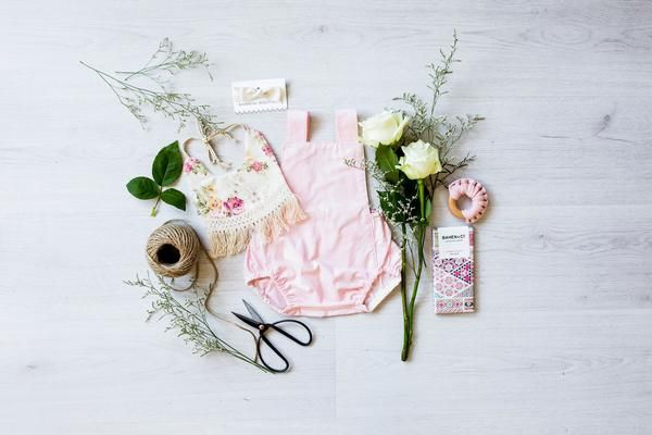 A gorgeous flatlay of our baby hamper gift box perfect for babyshower, maternity leave present. For the style conscious mum and her baby.