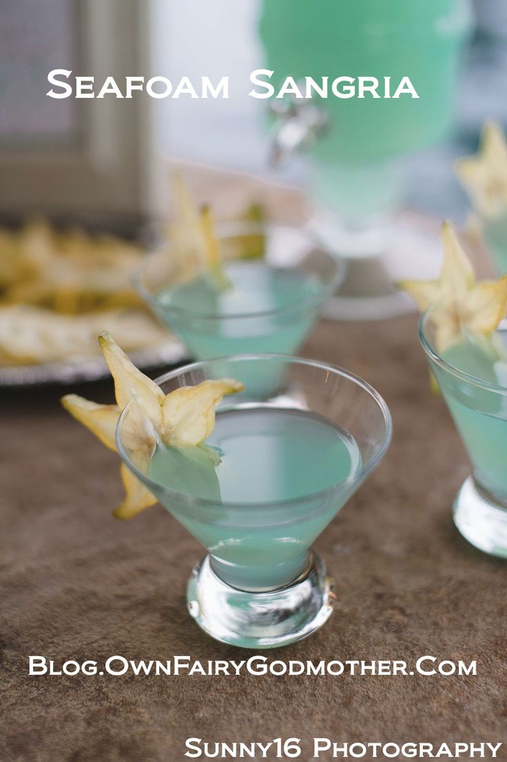 SeaFoam Sangria 3 Parts white wine, 2 parts blue Hypnotiq Liquer, 1 part Ginger Ale. So pretty!