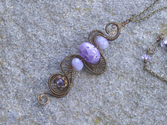 Bronze swirl with purple lilac art bead opalescent lilac pink