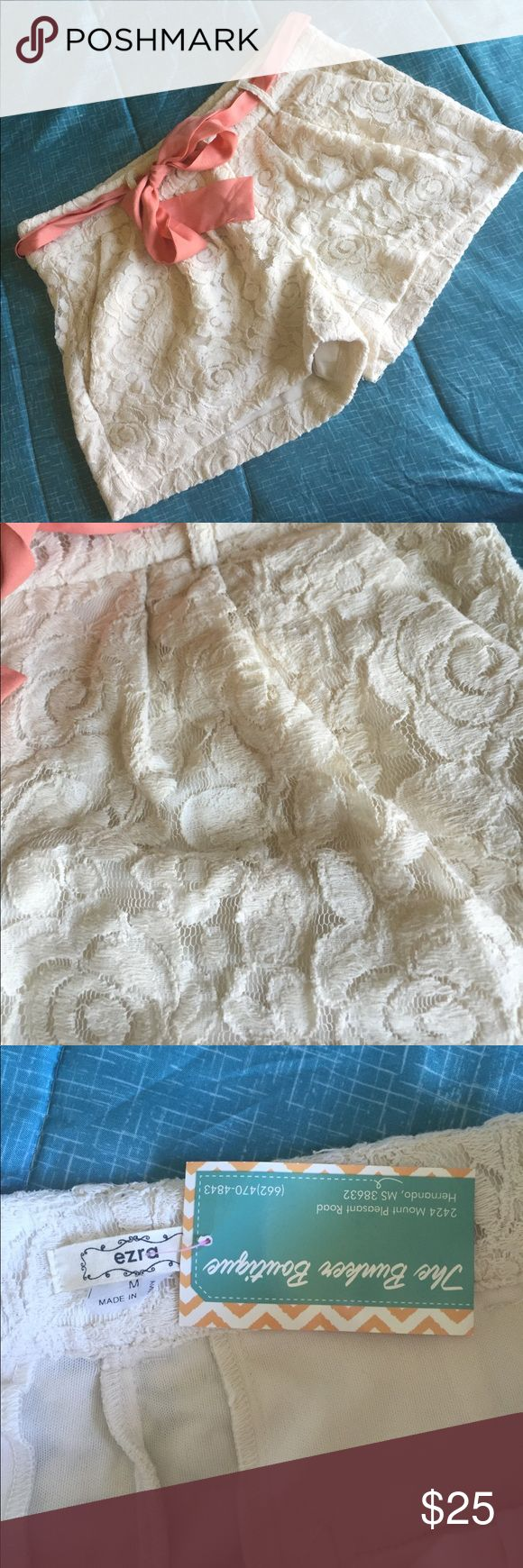 """NWT Adorable cream lace shorts So soft and chic! Cream lace shorts with a peach bow belt. NWT from local boutique. Sz Med, waist is 16"""" across when laid flat. 3"""" inseam. Shorts"""