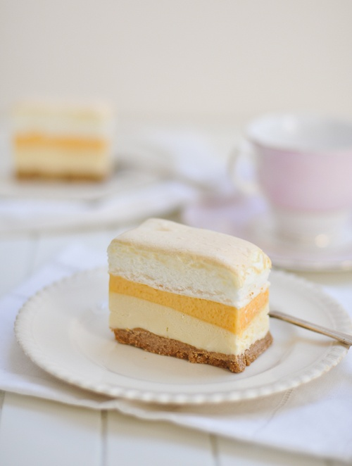 This fantastic frozen Brazo De Mercedes Cake has a layer of vanilla ice cream, meringue, custard and graham crust.  Can it get any better than this?!