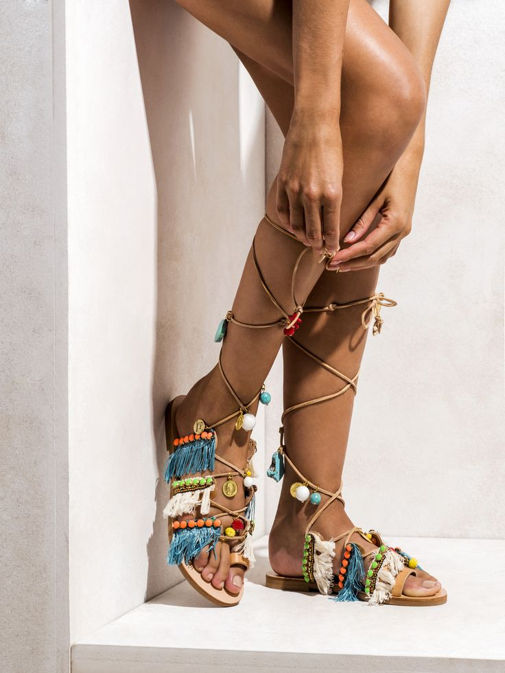 Handmade greek leather gladiators decorated with turquoise stones, corals, colorful glass beads, yellow pom poms, blue and white cotton straps (hand stitched) and neon acrylic beads.