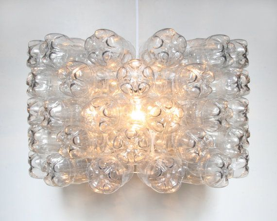 Recycled Plastic Soda Bottle Pendant Light - $300.00 This unique and recycled plastic lamp shade is constructed from repurposed plastic soda bottles. Each bottle is clear with a hint of gray when unlit, but as soon as you turn on the light they start glowing and twinkling, reflecting the light source like glass or crystal. This shade is 20 inches in diameter (51 cm) and 12 inches tall (30 cm) and features 5 layers of bottles.